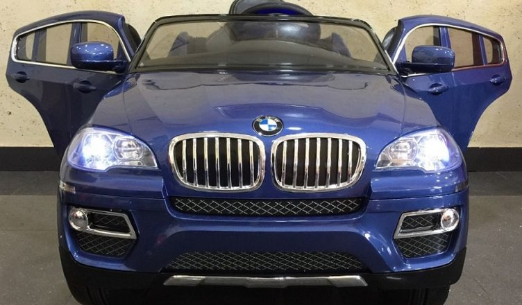 Coches infantiles bateria 12v bmw x6 color azul metalizado for Asientos infantiles coche